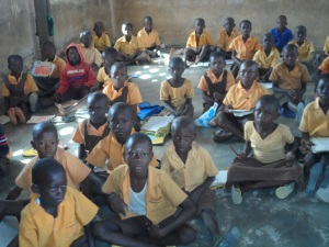 Lack of desks and chairs: pupils sitting on the bare floor