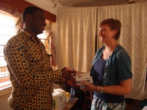 Rachael donating two cameras to Mr Vincent Subbey, director of Trax Ghana