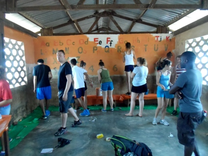 Students from British School of Brussels paint a primary school classroom