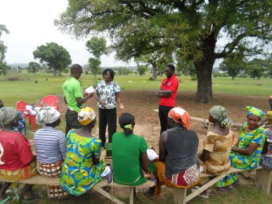 Trax Ghana's Sustainable Livelihoods Program Coordinator meets with one of our beneficiary farmer groups
