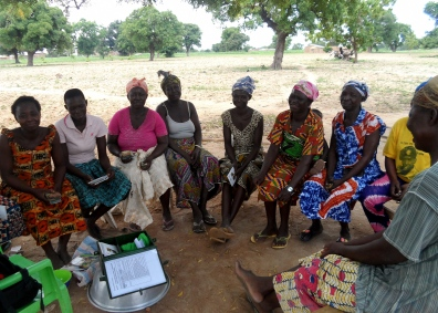 A women farmers group gathering for their weekly Village Savings and Loans Association meeting