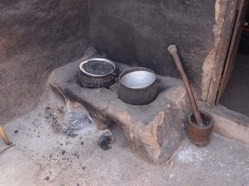 A double improved mud stove which has closed sides and requires less fire wood, is quicker and safer to use