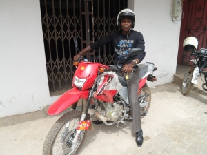 Schools Project Coordinator Botozan on his new motorbike