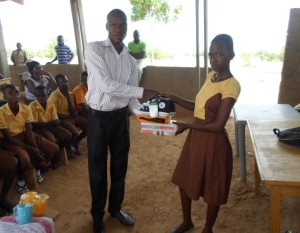SLPC William Adongo with one of the beneficiaries at Dachio
