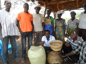 Trax Ghana staff with displayed Borassus Products of a household in Mozio community