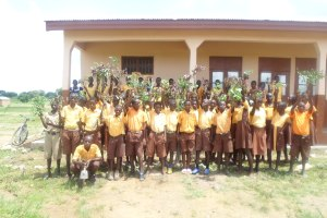 Pupils with tree seedling