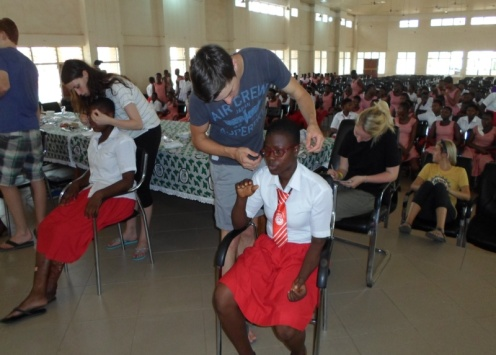 Hands out Glasses to student-BOGISS