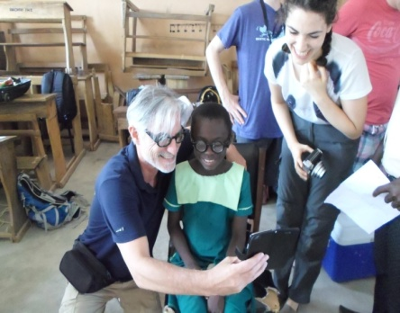 Hands out Glasses to Students-Dachio School